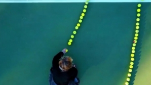 They made a portrait of Federer with thousands of tennis balls
